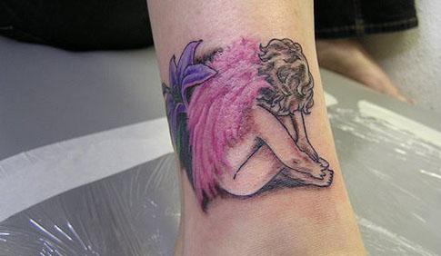 feminine tattoo design flower and angel tattoo expo. Black Bedroom Furniture Sets. Home Design Ideas