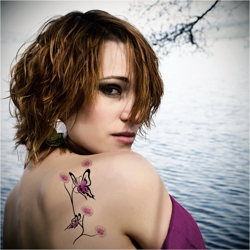 Beautiful feminine butterfly tattoos tattoo expo for Feminine tattoos with meaning